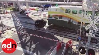Shocking CCTV footage shows train crash into SUV