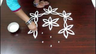 flower kolam with 7 to 4 interlaced dots- flower muggulu designs- simple flower rangoli designs