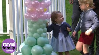 Prince George and Princess Charlotte play with balloons and pet animals