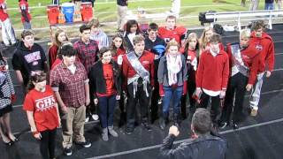 Godwin Madrigals singing the National Anthem at the Homecoming game