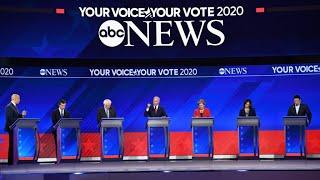 Frontrunners in Democratic debate spar over healthcare, stress unity