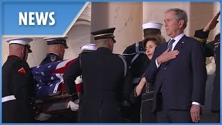Emotional George W. Bush watches his father