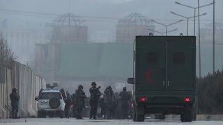 Twin Taliban blasts near Afghan parliament kill dozens