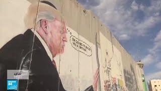 الضفة الغربية.. رسم غرافيتي لترامب على جدار الفصل يجذب السياح الأجانب