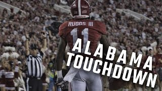 Henry Ruggs III catches the ball in the end zone for an Alabama touchdown
