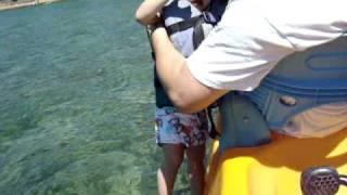 Ruth covers eyes to keep water away in Lake Tahoe