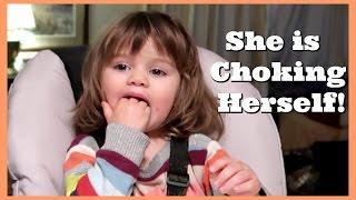 SHE IS CHOKING HERSELF!