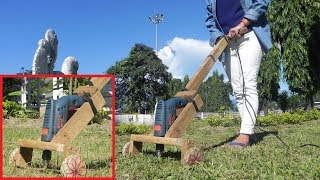 How to make a lawn mover/grass cutter from a drill machine .
