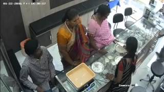 Lady thief at jewellery shop