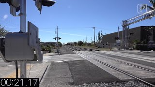 Video: Brightline vs. Freight train at a crossing
