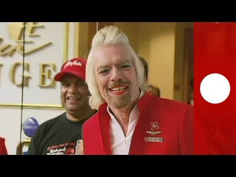Virgin Group founder Richard Branson works as stewardess for a day