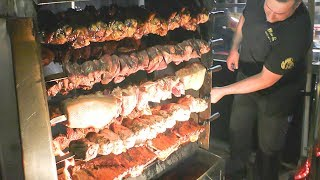 Germany Street Food. Huge Swords of Pork Knuckles and Mixed Meat on Grill