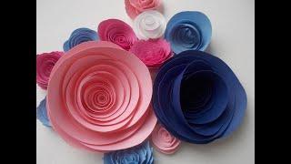 Como hacer flores de papel enrolladas.