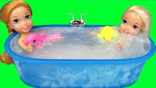 Bath ICE Trouble !  Elsa & Anna toddlers ! Bubbles - Foam - Messy floor