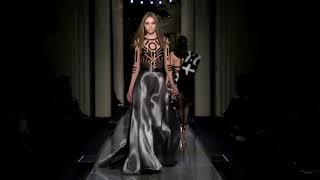 Hot runway model wearing silver satin evening gown-- Atelier Versace