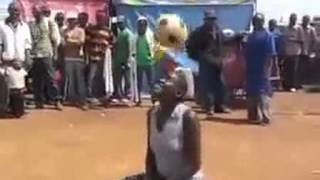 Woman juggling a ball in Africa