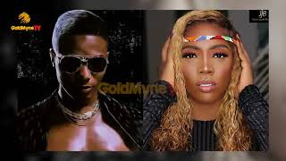 WIZKID AND TIWA CAUGHT KISSING AT A CLUB IN GHANA