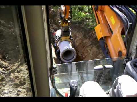 Kubota KX080 sewer construction