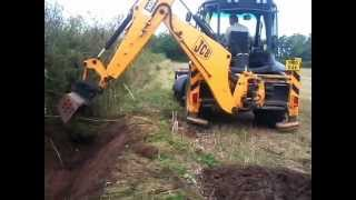 JCB cleaning out a ditch