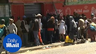 People loot goods from store as riots continue in Johannesburg