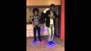 Boys dance to The Wave in light up shoes