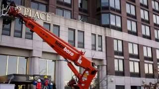 Trump Place signs being removed from buildings in the Upper West Side.