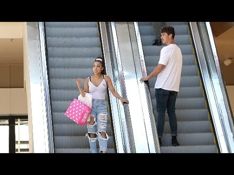 STARING AT STRANGERS ON THE ESCALATOR PRANK