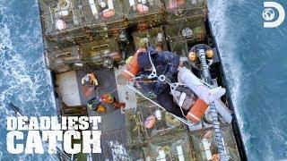 Coast Guard Rescues Injured Deckhand | Deadliest Catch