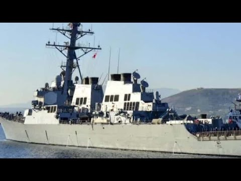 watch US Navy ship fires warning shots at Iranian boats