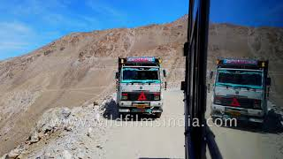 Drive to Spiti through rugged dusty river valley, as bus clings to steep cliff, at speed!