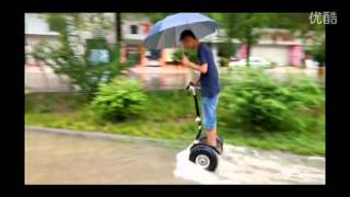 two off-road big wheel segway riding in the water