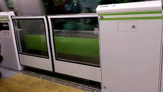 Tokyo Japan gates at train podiums subway stations preventing access to tracks