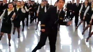 Chinese flight attendants dance during travel rush