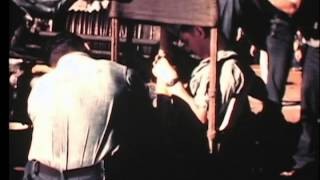 Excellent 16mm footage of personnel being transferred between moving war ships