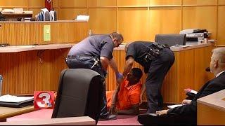 Courtroom fight erupts during murder hearing