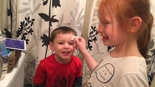 The G-Kids put on clown make-up