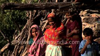Rural Indian village girls stand outside their house - Udaipur