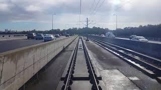 Transperth B series EMU cab view approaching Perth city across Mt Henry bridge.