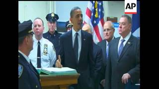 President Barack Obama greets NYPD officers who were at the World Trade Center site on Sept. 11, 200