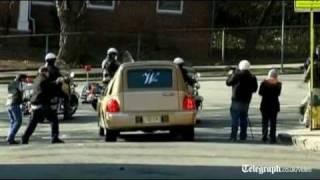Whitney Houston's golden hearse arrives at church