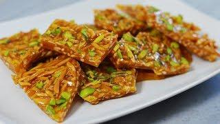 طرز تهیه سوهان عسلی ترد | شیرینی عید نوروز