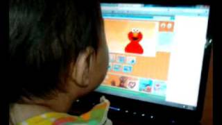 Baby playing an Elmo game on the computer