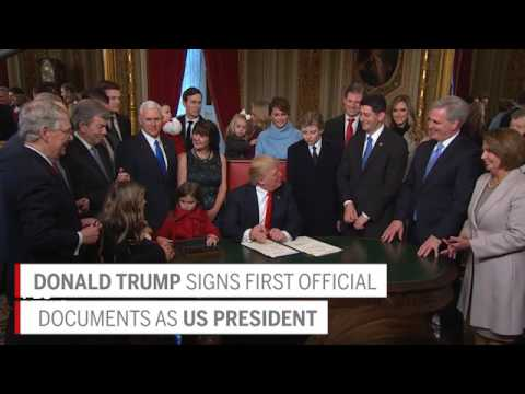 watch Trump signs first official documents as US president