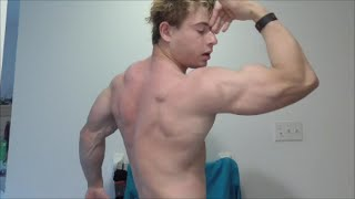 The Blonde Savage Flexing His Shredded Muscles and Cutting Down a Tree