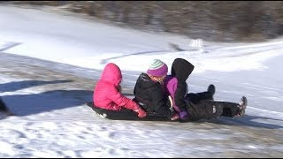 Watch out below! No school day means sled day