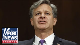 FBI Director Christopher Wray testifies at a Senate hearing
