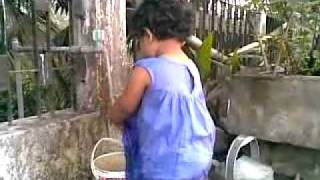 Bangla kid funny video - baby girl playing with water in the roof - 06032010