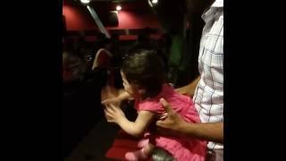 Batul the one yr old at a movie
