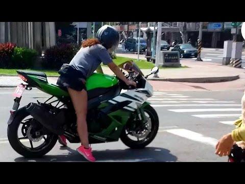 Little Asian Girl Rides a Big......Bike.