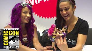 Sasha Banks and Bayley play with their new WWE Superstars dolls